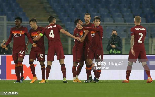 Edin Dzeko of A.S Roma celebrates with teammates after scoring his team's first goal during the UEFA Europa League Round of 32 match between AS Roma...