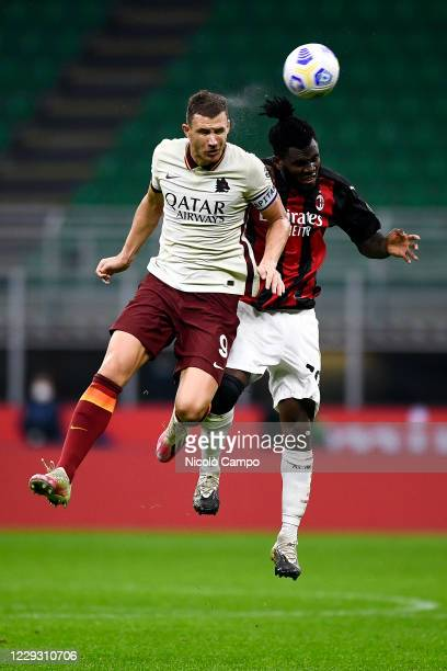Edin Dzeko of AS Roma competes for a header with Franck Kessie of AC Milan during the Serie A football match between AC Milan and AS Roma The match...