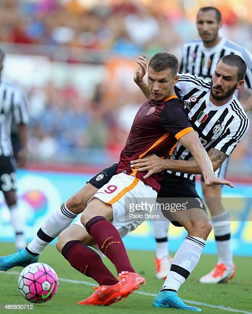 Edin Dzeko of AS Roma competes for the ball with Alessandro Bonucci of Juventus FC during the Serie A match between AS Roma and Juventus FC at Stadio...