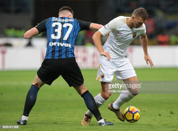 Edin Dzeko of AS Roma competes for the ball with Milan Skriniar of FC Internazionale Milano during the Serie A match between FC Internazionale and AS...