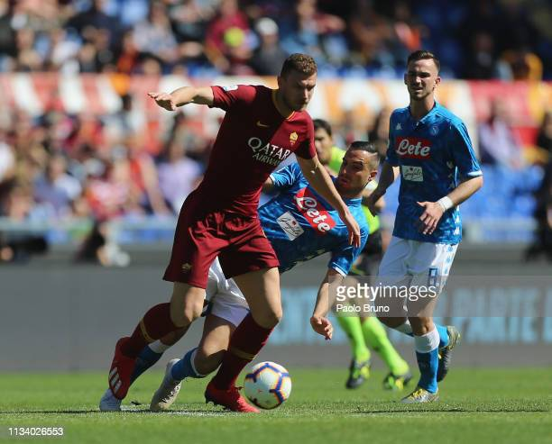 Edin Dzeko of AS Roma competes for the ball with Nikola Maksimovic of SSC Napoli during the Serie A match between AS Roma and SSC Napoli at Stadio...