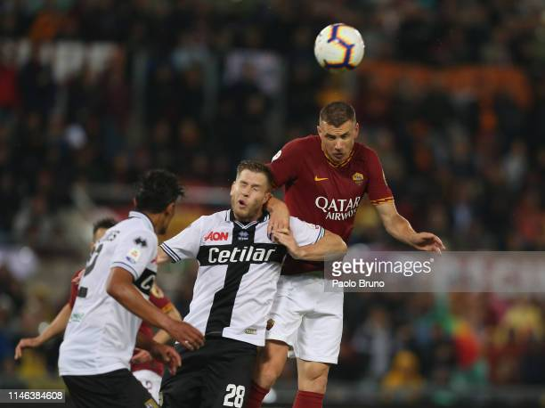 Edin Dzeko of AS Roma competes for the ball with Riccardo Gagliolo of Parma Calcio during the Serie A match between AS Roma and Parma Calcio at...