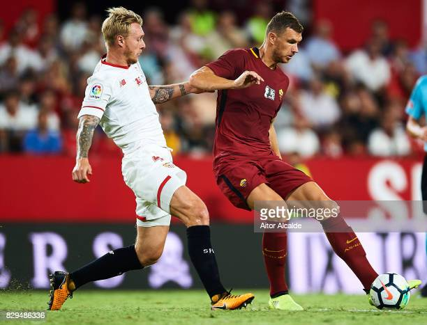 Edin Dzeko of AS Roma competes for the ball with Simon Kjaer of Sevilla FC during a Pre Season Friendly match between Sevilla FC and AS Roma at...