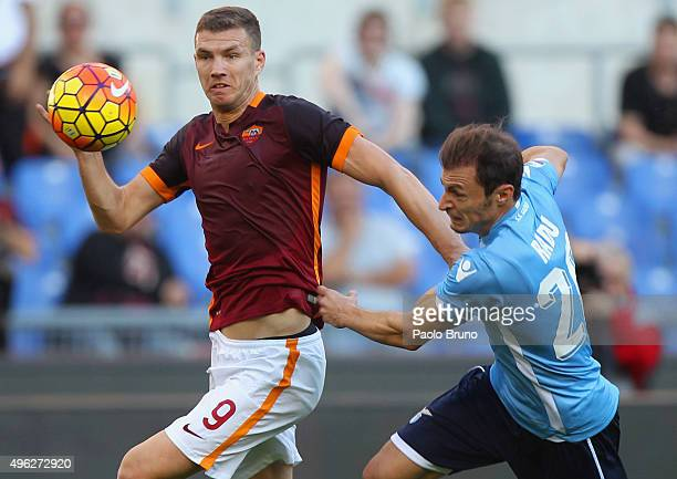 Edin Dzeko of AS Roma competes for the ball with Stefan Radu of SS Lazio during the Serie A match between AS Roma and SS Lazio at Stadio Olimpico on...