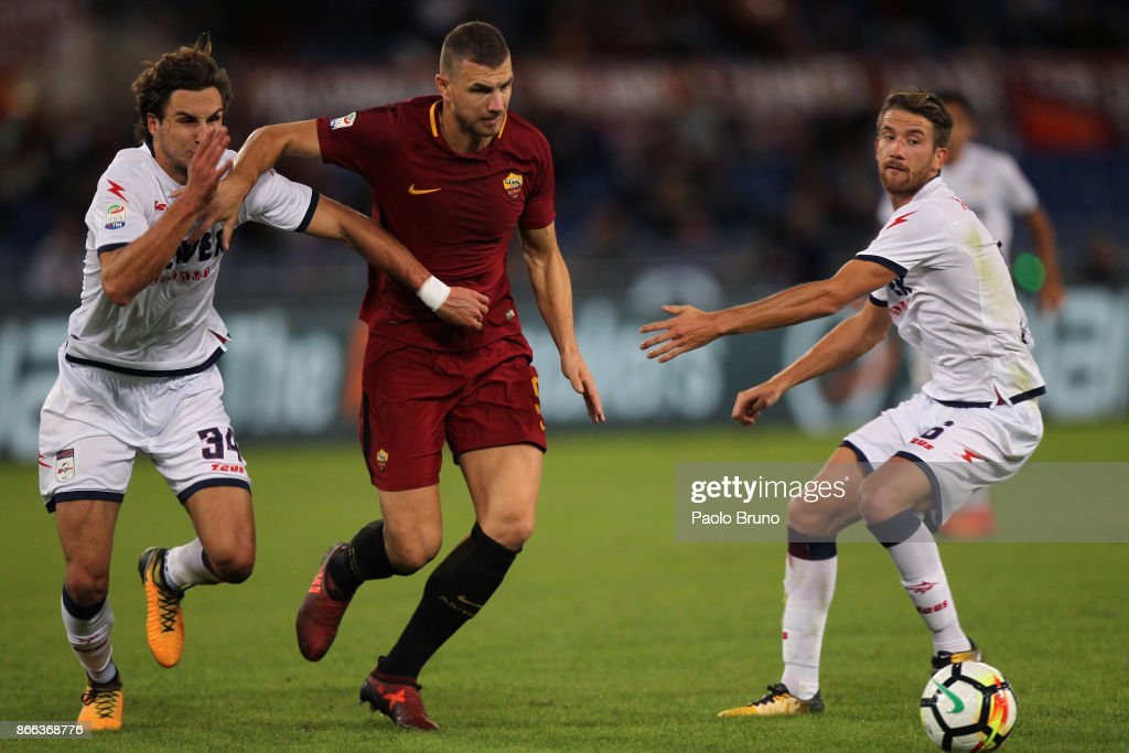 Edin Dzeko of AS Roma competes for the ball with Stefan Simic of FC Crotone during the Serie A match between AS Roma and FC Crotone at Stadio Olimpico on October 25, 2017 in Rome, Italy.