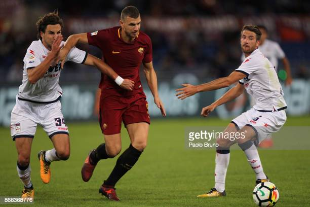 Edin Dzeko of AS Roma competes for the ball with Stefan Simic of FC Crotone during the Serie A match between AS Roma and FC Crotone at Stadio...