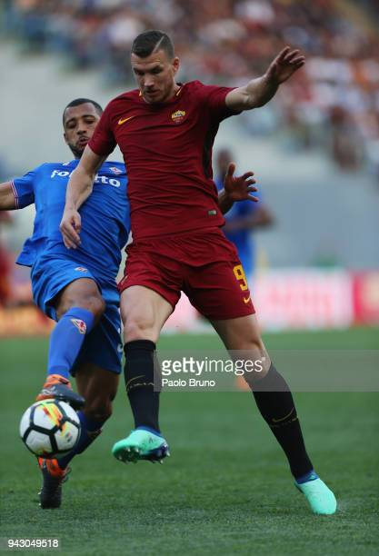 Edin Dzeko of AS Roma competes for the ball with Vitor Hugo of ACF Fiorentina during the serie A match between AS Roma and ACF Fiorentina at Stadio...