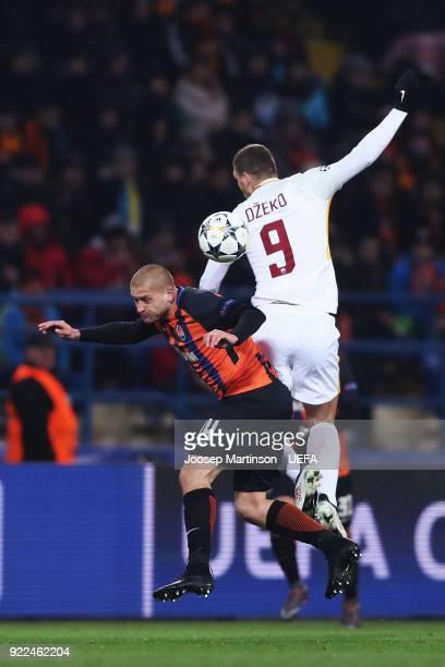 Edin Dzeko of AS Roma competes with Yaroslav Rakitskiy of Shakhtar Donetsk during the UEFA Champions League Round of 16 First Leg match between...