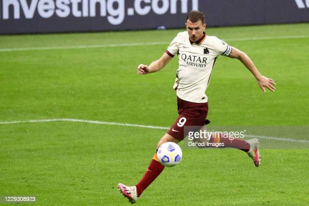 Edin Dzeko of AS Roma controls the ball during the Serie A match between AC Milan and AS Roma at Stadio Giuseppe Meazza on October 26 2020 in Milan...