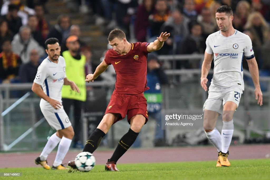 Edin Dzeko (C) of AS Roma in action against Gary Cahill (R) of Chelsea FC during the UEFA Champions League Group C match between AS Roma and Chelsea FC at Stadio Olimpico in Rome, Italy on October 31, 2017.