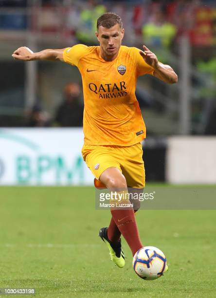 Edin Dzeko of AS Roma in action during the serie A match between AC Milan and AS Roma at Stadio Giuseppe Meazza on August 31 2018 in Milan Italy