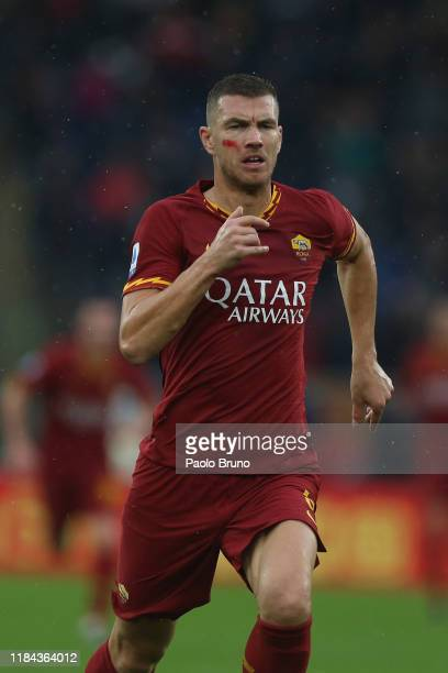 Edin Dzeko of AS Roma in action during the Serie A match between AS Roma and Brescia Calcio at Stadio Olimpico on November 24 2019 in Rome Italy