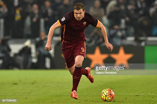 Edin Dzeko of AS Roma in action during the Serie A match between Juventus FC and AS Roma at Juventus Arena on January 24 2016 in Turin Italy