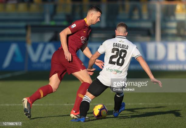 Edin Dzeko of AS Roma is challenged by Riccardo Gagliolo of Parma Calcio during the Serie A match between Parma Calcio and AS Roma at Stadio Ennio...