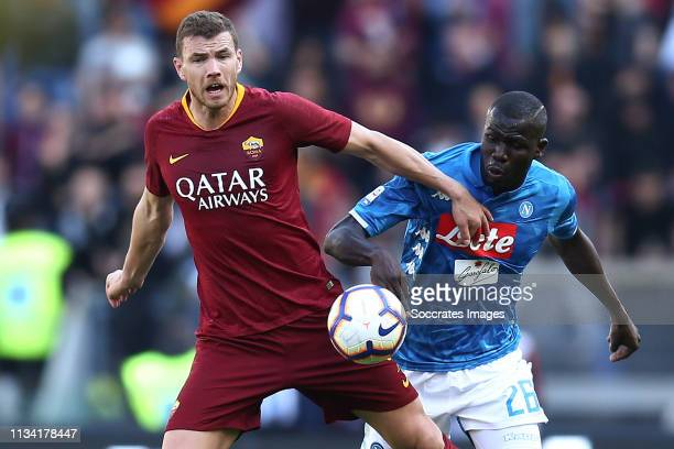 Edin Dzeko of AS Roma Kalidou Koulibaly of SSC Napoli during the Italian Serie A match between AS Roma v Napoli at the Stadio Olimpico Rome on March...