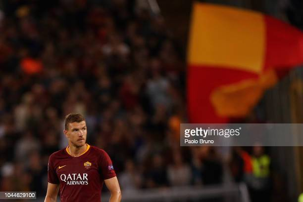 Edin Dzeko of AS Roma looks on after scoring the team's second goal during the Group G match of the UEFA Champions League between AS Roma and...