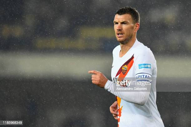 Edin Dzeko of As Roma looks on during the Serie A match between Hellas Verona and AS Roma at Stadio Marcantonio Bentegodi on December 1 2019 in...