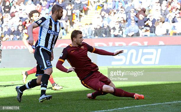 Edin Dzeko of AS Roma scores his opening goal during the Serie A match between Udinese Calcio and AS Roma at Stadio Friuli on March 13 2016 in Udine...