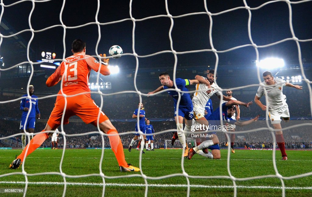 Edin Dzeko of AS Roma scores his second and Roma's 3rd goal past Thibaut Courtois of Chelsea during the UEFA Champions League group C match between Chelsea FC and AS Roma at Stamford Bridge on October 18, 2017 in London, United Kingdom.
