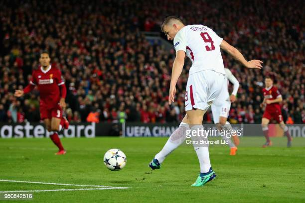 Edin Dzeko of AS Roma scores his sides first goal during the UEFA Champions League Semi Final First Leg match between Liverpool and AS Roma at...