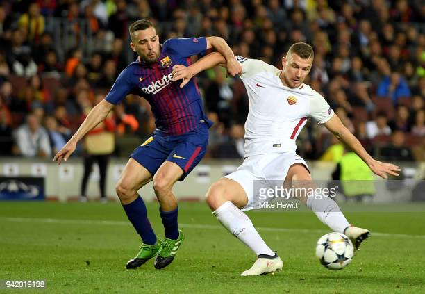 Edin Dzeko of AS Roma scores his sides first goal while under pressure from Jordi Alba of Barcelona during the UEFA Champions League Quarter Final...