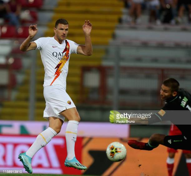 Edin Dzeko of AS Roma scores the opening goal during the preseason friendly match between AC Perugia and AS Roma at Stadio Renato Curi on July 31...