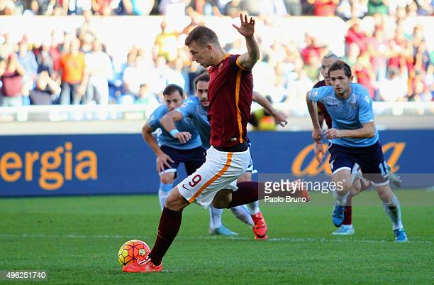 Edin Dzeko of AS Roma scores the opening goal from penalty spot during the Serie A match between AS Roma and SS Lazio at Stadio Olimpico on November...