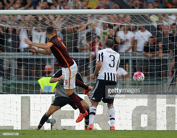 Edin Dzeko of AS Roma scores the team's second goal during the Serie A match between AS Roma and Juventus FC at Stadio Olimpico on August 30, 2015 in...