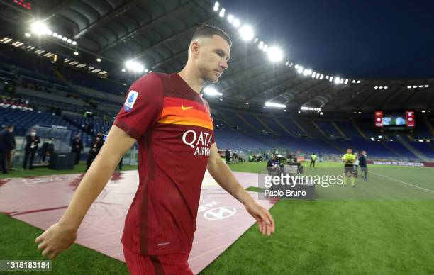 Edin Dzeko of A.S Roma walks out onto the pitch during the Serie A match between AS Roma and SS Lazio at Stadio Olimpico on May 15, 2021 in Rome,...