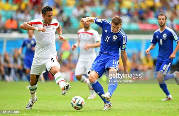 Edin Dzeko of Bosnia and Herzegovina shoots and scores his team's first goal during the 2014 FIFA World Cup Brazil Group F match between Bosnia and...