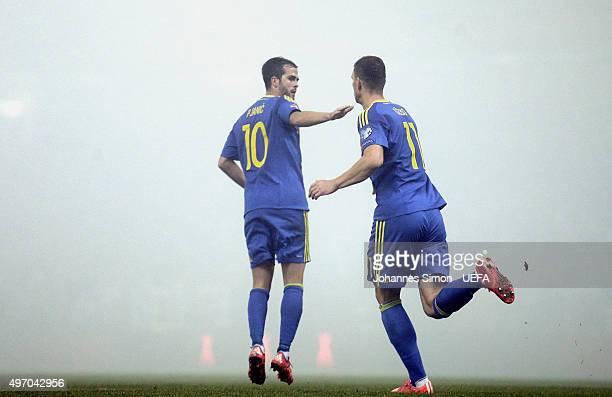 Edin Dzeko of Bosnia celebrates with team mate Miralem Pjanic after scoring their first goal during the EURO 2016 Qualifier PlayOff First Leg at...