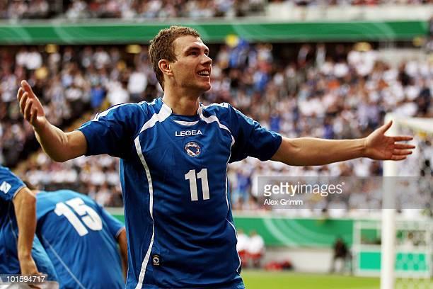 Edin Dzeko of BosniaHerzegovina celebrates after scoring his team's first goal during the international friendly match between Germany and...