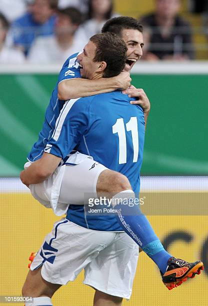 Edin Dzeko of Bosnia-Herzegovina celebrates with his team mate Vedad Ibisevic after scoring his team's first goal during the international friendly...