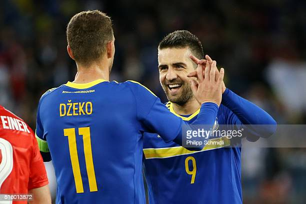 Edin Dzeko of BosniaHerzegovina celebrates with teammate Vedad Ibisevic after scoring his team's opening goal during the international friendly match...