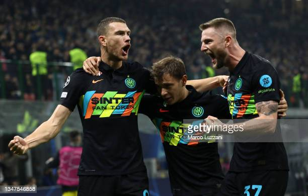 Edin Dzeko of FC Internazionale celebrates after scoring their side's first goal with Nicolo Barella and Milan Skriniar during the UEFA Champions...
