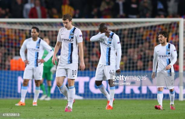 Edin Dzeko of Manchester City and team mates look dejected after conceding the opening goal during the UEFA Champions League Round of 16 match...