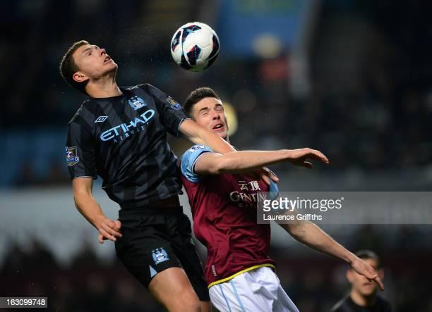 Edin Dzeko of Manchester City battles with Ciaran Clark of Aston Villa during the Barclays Premier League match between Aston Villa and Manchester...