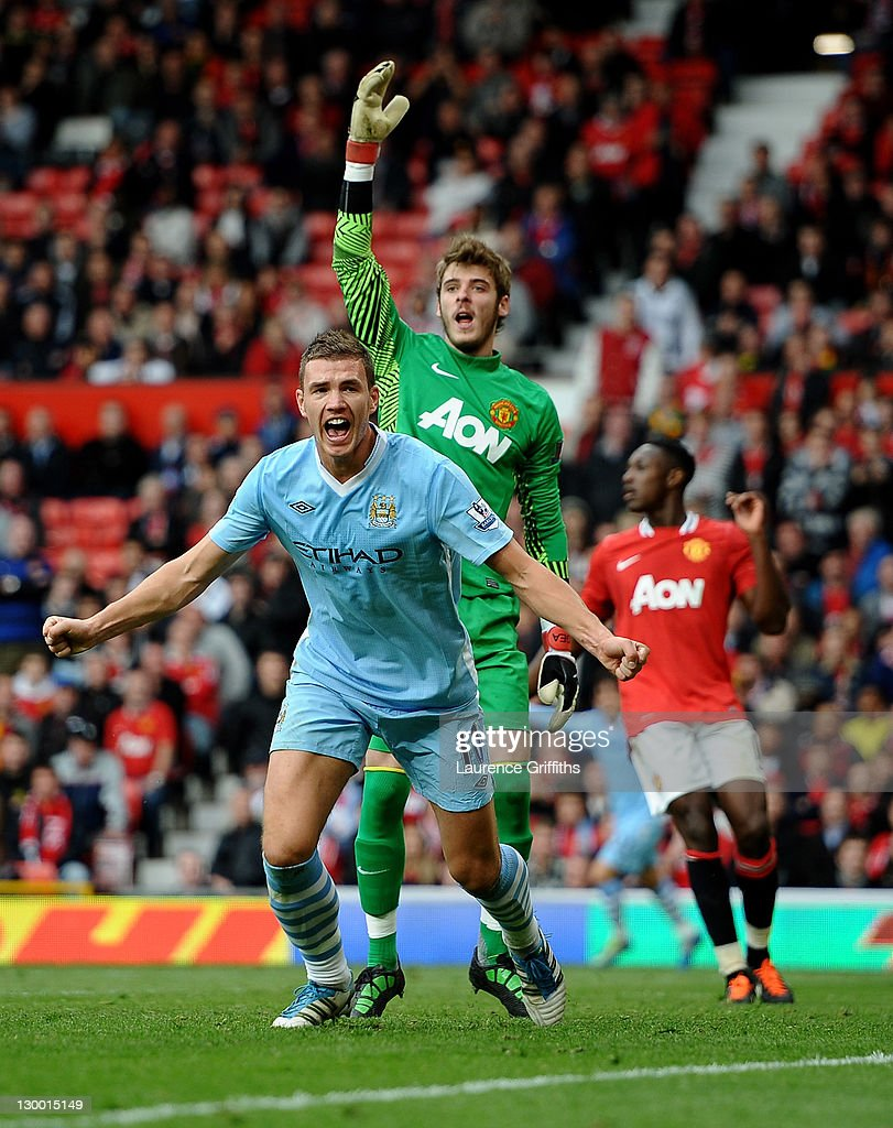 Edin Dzeko of Manchester City celebrates scoring his team's fourth goal during the Barclays Premier League match between Manchester United and Manchester City at Old Trafford on October 23, 2011 in Manchester, England.