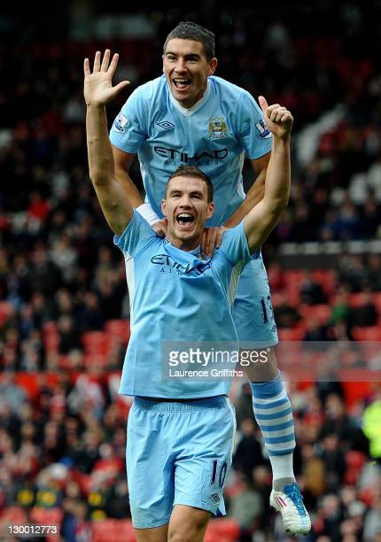 Edin Dzeko of Manchester City celebrates scoring his team's sixth goal with team mate Aleksandar Kolarov during the Barclays Premier League match...