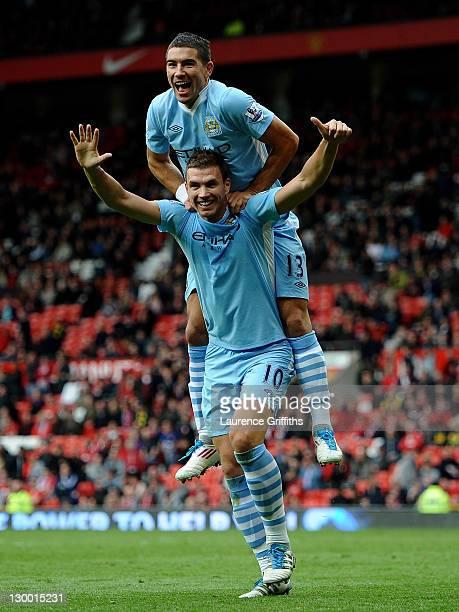 Edin Dzeko of Manchester City celebrates scoring his team's sixth goal with team mate Aleksandar Kolarov during the Barclays Premier League match...