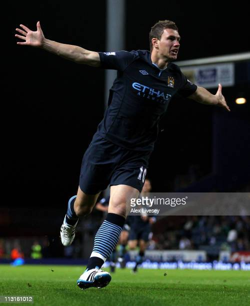 Edin Dzeko of Manchester City celebrates scoring the opening goal during the Barclays Premier League match between Blackburn Rovers and Manchester...