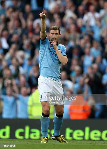 Edin Dzeko of Manchester City celebrates scoring the opening goal during the Barclays Premier League match between Manchester City and West Bromwich...
