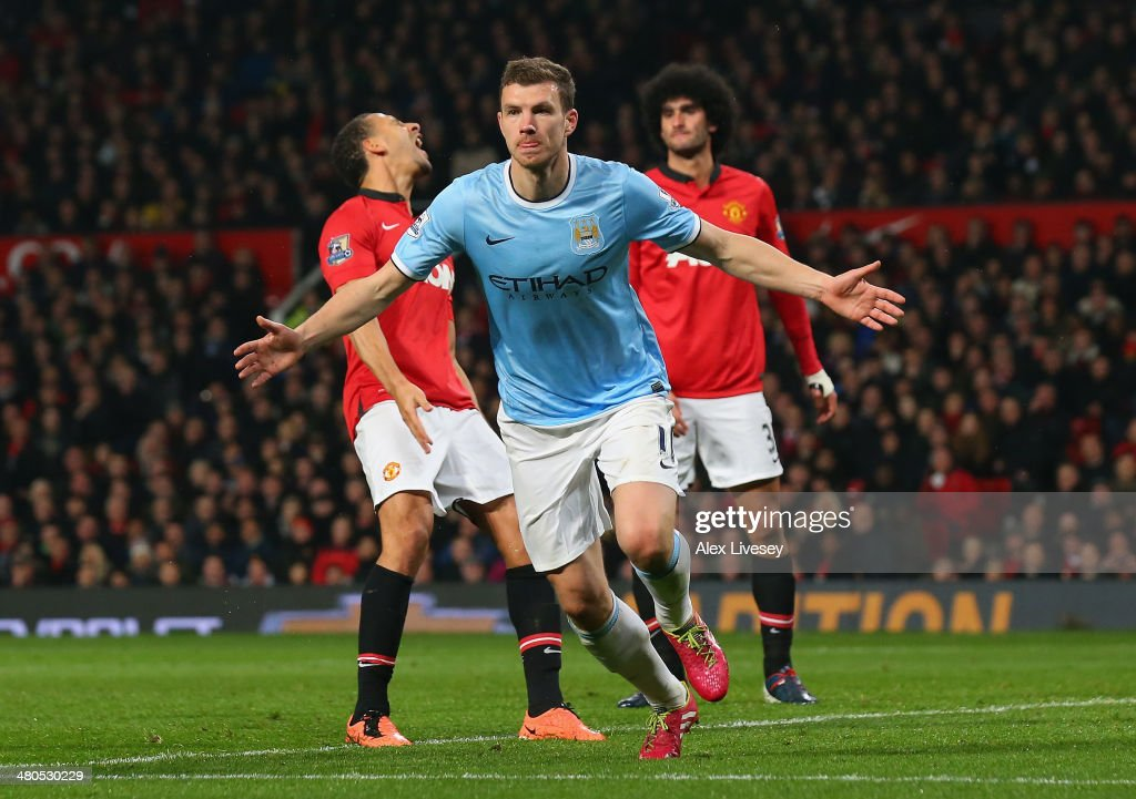 Edin Dzeko of Manchester City celebrates scoring the second goal during the Barclays Premier League match between Manchester United and Manchester City at Old Trafford on March 25, 2014 in Manchester, England.