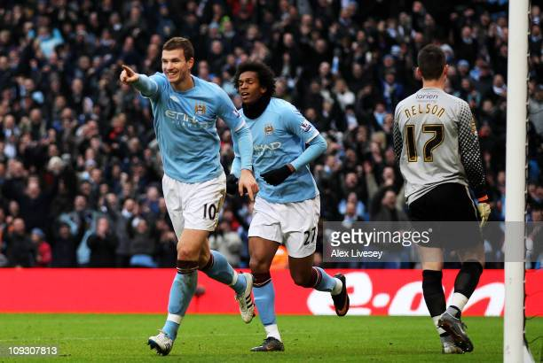 Edin Dzeko of Manchester City celebrates scoring their fourth goal during the FA Cup sponsored by E.On 4th Round replay match between Manchester City...