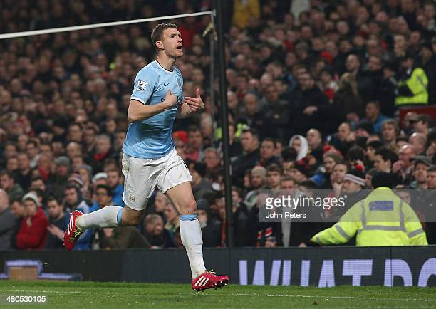 Edin Dzeko of Manchester City celebrates scoring their second goal during the Barclays Premier League match between Manchester United and Manchester...