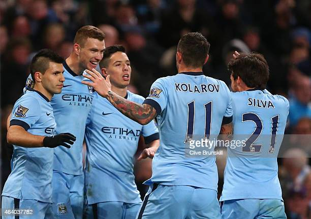 Edin Dzeko of Manchester City celebrates scoring their third goal with team mates during the Barclays Premier League match between Manchester City...