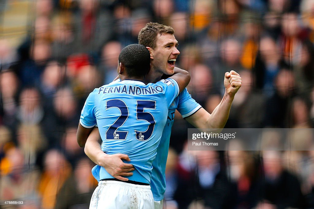 Edin Dzeko of Manchester City celerates with teammate Fernandinho after scoring his team's second goal during the Barclays Premier league match between Hull City and Manchester City at KC Stadium on March 15, 2014 in Hull, England.