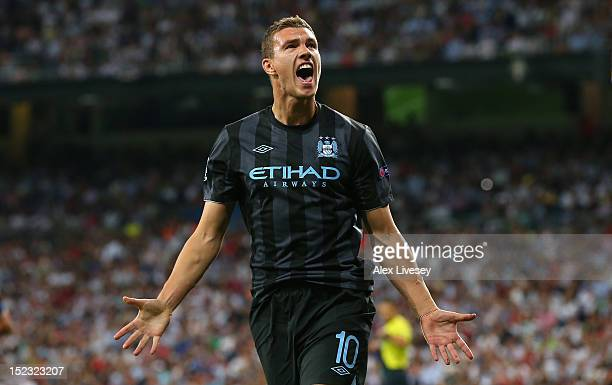 Edin Dzeko of Manchester City FC celebrates after scoring the opening goal during the UEFA Champions League Group D match between Real Madrid and...