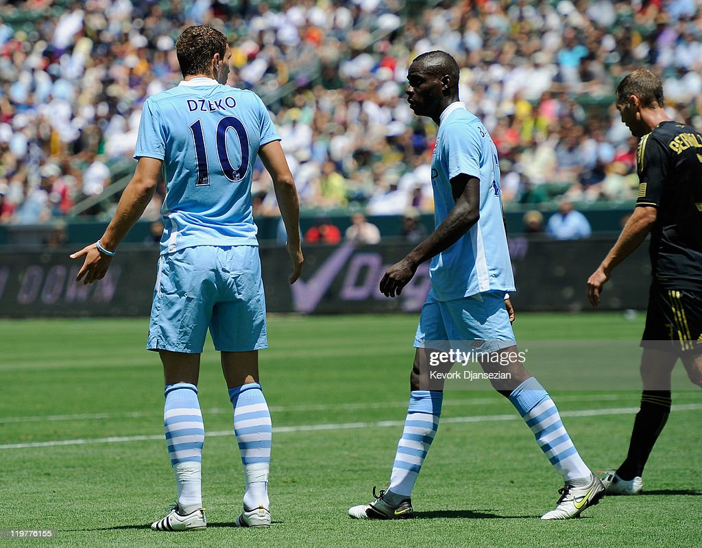 Edin Dzeko #10 of Manchester City has words with teammate Mario Balotelli #45 after blasting the ball into the net he inexplicably tried to score with a spinning backheel which went wide of the target against the Los Angeles Galaxy during the Herbalife World Football Challenge 2011 at the Home Depot Center on July 24, 2011 in Carson, California.