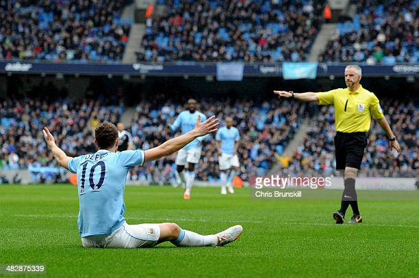 Edin Dzeko of Manchester City is awarded a penalty by referee Chris Foy after he is brought down by Jose Fonte of Southampton uduring the Barclays...